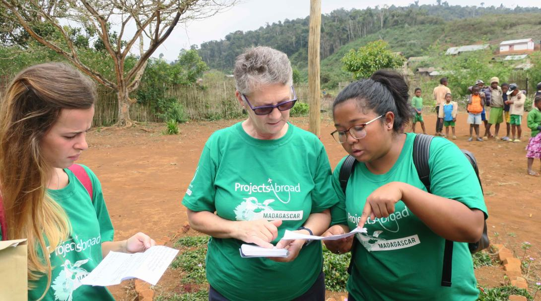 Projects Abroad volunteers doing a Public Health internship record data in Madagascar.